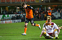 Dundee Utd's Charlie Telfer celebrates after he scores their third goal.