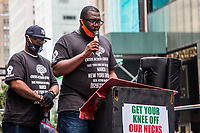 NEW YORK, NY - JULY 31: George Floyd's brother Terrence Floyd together with Reverend Kevin McCall in front of the Trump Tower on 5 Av on July 31, 2020 in New York City. Since the murder of George Floyd by a Minneapolis police officer on May 25, millions of Americans have taken to the streets demanding more police accountability, reform and, in some cases, a lack of police funds. Many of the events took place next to the Trump Tower at 5 Av in Manhattan. (Photo by Pablo Monsalve / VIEWpress)