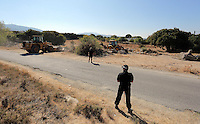 Pictured: Police officers oversee the diggers that work to clear the new site of the search, where rubble was deposited from the farmhouse where Ben Needham disappeared from in Kos, Greece. Thursday 06 October 2016<br />
