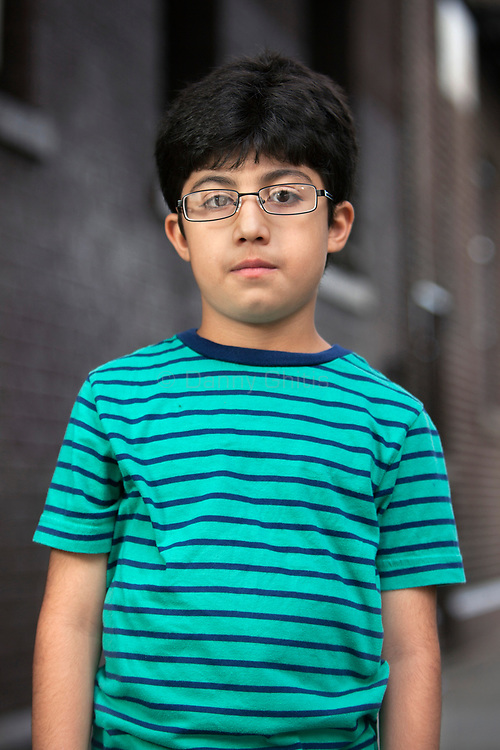 Khalid Al Shok, 9, fled Iraq with his family after his father worked with US Army as an interpreter. He arrived in New York in December 2013. <br /> <br /> Photo by Danny Ghitis