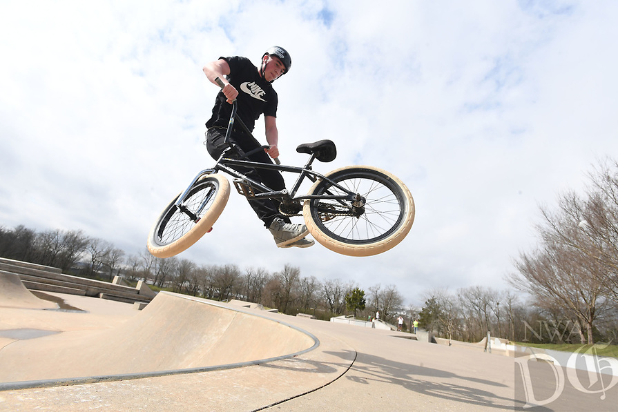 NWA Democrat-Gazette/J.T. WAMPLER Luke Peavey of Benton works on a trick Sunday March 24, 2019 at Walker Park in Fayetteville. Peavey traveled to Northwest Arkansas to try the various bicycle attractions and had already been to Rogers and Springdale before landing at Walker Park.