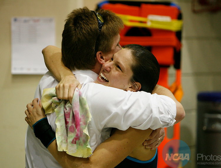 17 MAR 2007:  Jamie Wolf from Clarion University is congratuled by her diving coach, Dave Hrovat after competeing in the 3 mtr diving during the Division II Women's Swimming and Diving Championship held at the Flickinger Center in Buffalo, NY.  Wolf, scored 499.15 to win the national title.  Harry Scull/NCAA Photos.