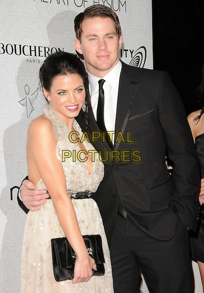 "JENNA DEWAN & CHANNING TATUM.Art of Elysium 3rd Annual Black Tie charity gala '""Heaven"" held at 990 Wilshire Blvd in Beverly Hills, California, USA, .January 16th 2010 .half length dress low cut plunging neckline cleavage clutch bag halterneck black white lace grey gray black suit jacket hand in pocket married husband wife .CAP/RKE/DVS .©DVS/RockinExposures/Capital Pictures"