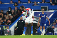 Wilfried Zaha of Crystal Palace looked to be struggling with an injury in the second half during Chelsea vs Crystal Palace, Premier League Football at Stamford Bridge on 4th November 2018