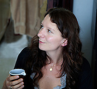 Attractive Polish woman having a cup of tea in her home age 32. Zawady Central Poland