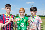 Adam Gul Kenmare, Robert Stack Ballybunion and Paddy Falvey Listellick North show off their medals they won  at the County Primary schools athletics championships in An Riocht Castleisland on Saturday