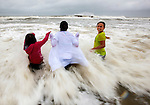 ST GEORGE ISLAND, FL- JUNE 6:  From left, Ryleigh Fisher, her sister Holly Fisher and cousin Hannah Helm, from Elizabethtown, KY play in the heavy rain and surf on St George Island, FL as tropical storm Andrea approaches the Florida panhandle. St George Island is located between Carrabelle, and Apalachicola, FL.  <br />