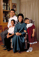 HISPANIC (MEXICAN-AMERICAN) FAMILY IN THE LIVING ROOM. HISPANIC FAMILY. FRESNO CALIFORNIA.