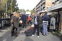 Roma, 23 Novembre 2011.Via Casal Boccone.Presidio di anziani , cittadini e lavoratori della Casa di riposo Roma 2 contro lo sgombero della struttura e il trasferimento degli anziani.una donna anziana si stende in strada per impedire l'uscita