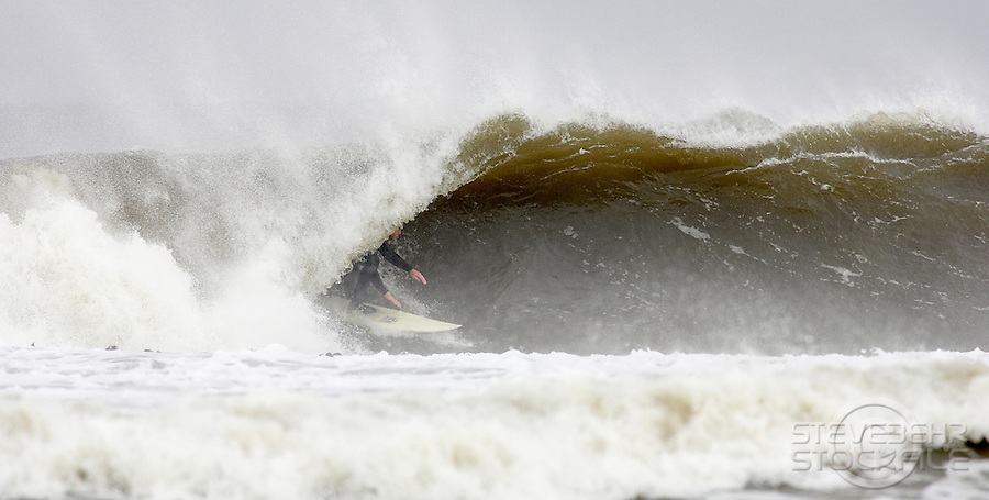 Surfing at the Cove..Nr Whitby , North Yorkshire ..October 2008..pic copyright Steve Behr / Stockfile