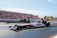 Aug 17, 2019; Brainerd, MN, USA; NHRA top fuel driver Steve Torrence (near) races alongside Mike Salinas during qualifying for the Lucas Oil Nationals at Brainerd International Raceway. Mandatory Credit: Mark J. Rebilas-USA TODAY Sports