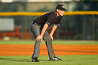 Umpire Alex Ziegler handles the calls on the bases during the Appalachian League game between the Bristol White Sox and the Burlington Royals at Burlington Athletic Park on July 9, 2011 in Burlington, North Carolina.  The Royals defeated the White Sox 3-2.   (Brian Westerholt / Four Seam Images)