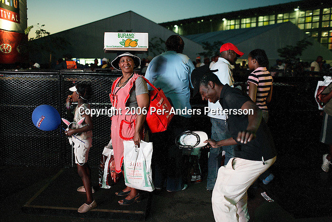 SOWETO, SOUTH AFRICA SEPTEMBER 23: People enjoy a concert on September 23, 2006 in Soweto, Johannesburg, South Africa. The concert was part of Soweto festival. Soweto is South Africa&rsquo;s largest township and it was founded about one hundred years to make housing available for black people south west of downtown Johannesburg. The estimated population is between 2-3 million. Many key events during the Apartheid struggle unfolded here, and the most known is the student uprisings in June 1976, where thousands of students took to the streets to protest after being forced to study the Afrikaans language at school. Soweto today is a mix of old housing and newly constructed townhouses. A new hungry black middle-class is growing steadily. Many residents work in Johannesburg but the last years many shopping malls have been built, and people are starting to spend their money in Soweto.  <br /> (Photo by Per-Anders Pettersson)