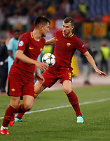 Roma s Edin Dzeko, right, in action during the Uefa Champions League quarter final second leg football match between AS Roma and FC Barcelona at Rome's Olympic stadium, April 10, 2018.<br /> UPDATE IMAGES PRESS/Riccardo De Luca
