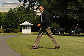 United States President Barack Obama walks across the South Lawn of the White House after arriving by Marine One, in Washington DC, USA, Sunday, 10 July 2011. .Credit: Michael Reynolds / Pool via CNP
