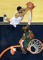 Virginia guard Malcolm Brogdon (15) reaches for the rebound with Miami center Tonye Jekiri (23) during an NCAA basketball game Saturday Feb, 24, 2014 in Charlottesville, VA. Virginia defeated Miami 65-40.