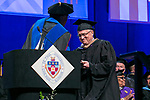 Robert Ryan, right, receives the Lawrence R. Ryan Teaching Award from Ray Whittington, dean of the Driehaus College of Business, Sunday, June 11, 2017, during the DePaul University Driehaus College of Business commencement ceremony at the Allstate Arena in Rosemont, IL. (DePaul University/Jamie Moncrief)