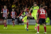 Bolton Wanderers' Daryl Murphy (2nd right)  competing with Lincoln City's Cian Bolger (centre) <br /> <br /> Photographer Andrew Kearns/CameraSport<br /> <br /> The EFL Sky Bet League One - Lincoln City v Bolton Wanderers - Tuesday 14th January 2020  - LNER Stadium - Lincoln<br /> <br /> World Copyright © 2020 CameraSport. All rights reserved. 43 Linden Ave. Countesthorpe. Leicester. England. LE8 5PG - Tel: +44 (0) 116 277 4147 - admin@camerasport.com - www.camerasport.com