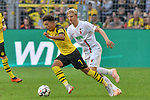 06.10.2018, Signal Iduna Park, Dortmund, GER, DFL, BL, Borussia Dortmund vs FC Augsburg, DFL regulations prohibit any use of photographs as image sequences and/or quasi-video<br /> <br /> im Bild v. li. im Zweikampf Jadon Sancho (#7, Borussia Dortmund) Martin Hinteregger (#36, FC Augsburg) <br /> <br /> Foto &copy; nph/Horst Mauelshagen