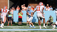 CHAPEL HILL, NC - SEPTEMBER 28: Sam Howell #7 of the University of North Carolina drops back to pass during a game between Clemson University and University of North Carolina at Kenan Memorial Stadium on September 28, 2019 in Chapel Hill, North Carolina.