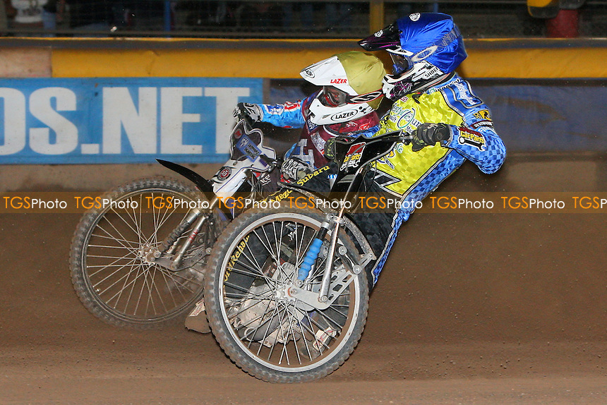Heat 5: Lewis Bridger (blue) and Stuart Robson - Eastbourne Eagles vs Lakeside Hammers - Elite League Speedway Play-Off Semi-Final 2nd Leg at Arlington Stadium - 26/09/11 - MANDATORY CREDIT: Gavin Ellis/TGSPHOTO - Self billing applies where appropriate - 0845 094 6026 - contact@tgsphoto.co.uk - NO UNPAID USE.