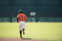 San Francisco Giants center fielder Heliot Ramos (31) jogs towards center field between innings of an Instructional League game against the Kansas City Royals at the Giants Training Complex on October 17, 2017 in Scottsdale, Arizona. (Zachary Lucy/Four Seam Images)