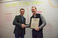 Wolf Starr of Connect Columbus shakes hands with Morgan Spurlock after presenting his with a proclamation from the state of Ohio congratulating him on the opening of his new restaurant.<br /> <br /> Morgan Spurlock opens &quot;Holy Chicken,&quot; a faux fast food restaurant in Columbus, Ohio, where a documentary crew recorded his interaction with customers who thought they were dining at a new type of fast food restaurant. However, the entire location was designed to be part of his documentary highlighting the marketing of food that may not be as healthy as it is stated in advertisement, banners, and notices at the restaurant.