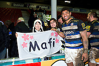 Amanaki Mafi of Bath Rugby poses for a photo with supporters after the match. Aviva Premiership match, between Gloucester Rugby and Bath Rugby on March 26, 2016 at Kingsholm Stadium in Gloucester, England. Photo by: Patrick Khachfe / Onside Images