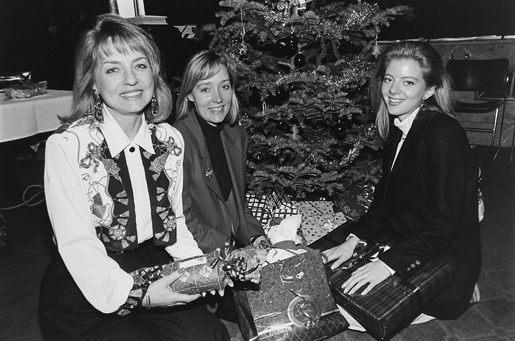 Three women instrumental in raising money and getting gifts (from the Seante Energy and Natural Resources Committee) for a near by family. Here at a party, Vicky Thorne, Leslie Palmer and Camille Heninger, in Decemeber 1993. (Photo by Maureen Keating/CQ Roll Call via Getty Images)