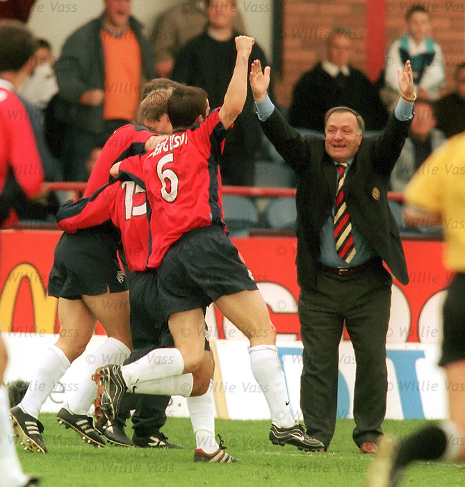 Dick Advocaat greets a Gabriel Amato goal at Dens Park in October 1999