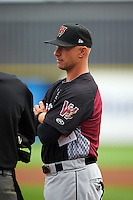 Wisconsin Timber Rattlers manager Matt Erickson (8) during the lineup exchange before the first game of a doubleheader against the Quad Cities River Bandits on August 19, 2015 at Modern Woodmen Park in Davenport, Iowa.  Quad Cities defeated Wisconsin 3-2.  (Mike Janes/Four Seam Images)