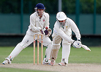 Dan Davis of Shepherds Bush plays and misses during the Middlesex Cricket League Division Two game between Shepherds Bush and Hornsey at Bromyard Ave, London on Sat Aug 1, 2015