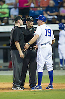 Burlington Royals manager Tommy Shields (19) argues a call with home plate umpire Brock Ballou  as base umpire Russ Weich looks on during the game against the Johnson City Cardinals at Burlington Athletic Park on July 14, 2014 in Burlington, North Carolina.  The Cardinals defeated the Royals 9-4.  (Brian Westerholt/Four Seam Images)