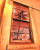 USA, Hawaii, Oahu, the North Shore, a palm tree and sunset reflect in the window of a building that was an old convent