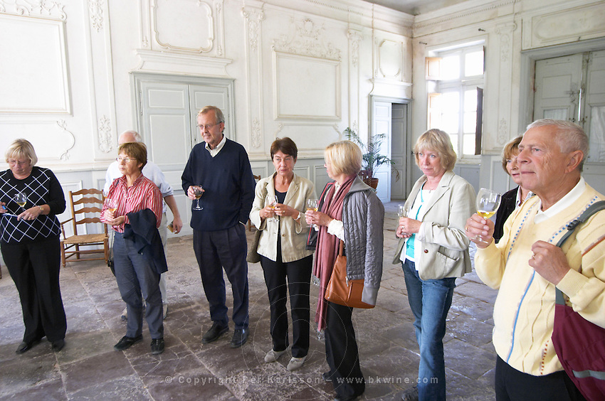 Visitors enjoying the Aperitif served in the entrance hall, a glass golden yellow of Chateau de Cerons  Chateau de Cerons (Cérons) Sauternes Gironde Aquitaine France
