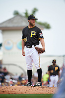 Pittsburgh Pirates pitcher Guido Knudson (63) looks in for the sign during a Spring Training game against the Toronto Blue Jays  on March 3, 2016 at McKechnie Field in Bradenton, Florida.  Toronto defeated Pittsburgh 10-8.  (Mike Janes/Four Seam Images)