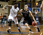 SIOUX FALLS, SD: MARCH 22: Robert Duncan #5 from Chico State tries to get a step past Luquon Choice #20 from Lincoln Memorial during the Men's Division II Basketball Championship Tournament on March 22, 2017 at the Sanford Pentagon in Sioux Falls, SD. (Photo by Dave Eggen/Inertia)