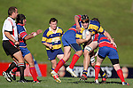 Andrew Van Der Heijden tries to break through the Ardmore Marist tacklers. McNamara Cup final - Premier 1 Championship, Patumahoe v Ardmore Marist. Patumahoe won 13 - 6. Counties Manukau club rugby finals played at Growers Stadium, Pukekohe, 24th of June 2006.
