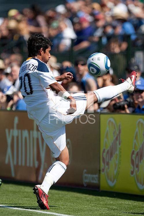 Los Angeles Galaxy defender A.J. DeLaGarza (20) tries to keep the ball in play.  The San Jose Earthquakes tied the Los Angeles Galaxy 0-0 at Buck Shaw Stadium in Santa Clara, California on June 25th, 2011.