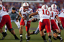 October 07, 2010: Nebraska quarterback Taylor Martinez (3) handing the ball off to Nebraska running back Roy Helu Jr. (10) at the Bill Snyder Family Stadium in Manhattan, Kansas. Nebraska defeated Kansas State 48 to 13.