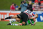 Siale Piutau takes Hadleigh Parkes to ground in a heavy tackle. ITM Cup rugby game between Counties Manukau and Manawatu played at Bayer Growers Stadium on Saturday August 21st 2010..Counties Manukau won 35 - 14 after leading 14 - 7 at halftime.