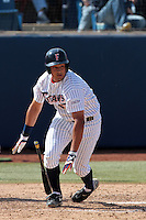 Carlos Lopez #17 of the Cal State Fullerton Titans bats against the TCU Horned Frogs at Goodwin Field on February 26, 2012 in Fullerton,California. Fullerton defeated TCU 11-10.(Larry Goren/Four Seam Images)