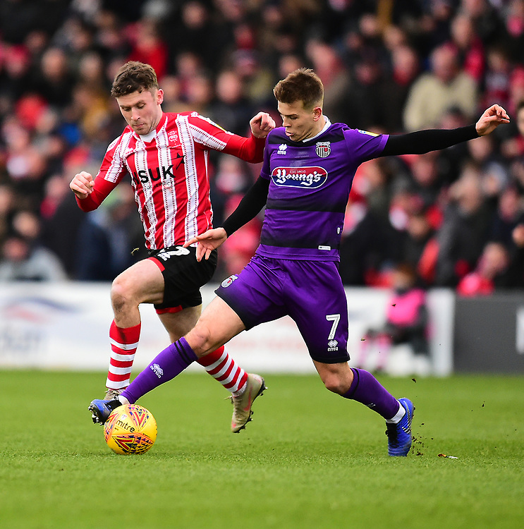 Lincoln City's Shay McCartan battles with Grimsby Town's Jake Hessenthaler<br /> <br /> Photographer Andrew Vaughan/CameraSport<br /> <br /> The EFL Sky Bet League Two - Lincoln City v Grimsby Town - Saturday 19 January 2019 - Sincil Bank - Lincoln<br /> <br /> World Copyright &copy; 2019 CameraSport. All rights reserved. 43 Linden Ave. Countesthorpe. Leicester. England. LE8 5PG - Tel: +44 (0) 116 277 4147 - admin@camerasport.com - www.camerasport.com