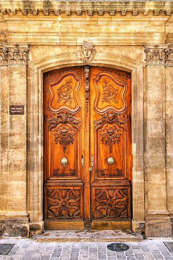 18th century carved wooden door, entrance to the Hotel d'Ailhaud, in Aix-en-Provence