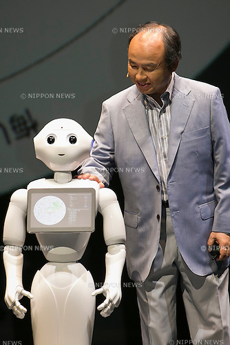 Masayoshi Son, chairman & CEO of Japanese internet and telecommunications giant SoftBank Corp., announces that its robot Pepper can feel and understand people's emotions and also express itself, during a press conference on June 18, 2015, Tokyo, Japan. Son also announced that the first 1000 robots will be on sale to the public for 198,000 JPY (1,604 USD) from Saturday June 20th, and could be available to companies to replace positions such as reception and convenience store staff from the beginning of July. To develop Pepper's skills SoftBank announced an alliance with foreign technology companies FOXCONN and Alibaba Group. (Photo by Rodrigo Reyes Marin/AFLO)