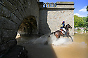 18/05/14<br /> <br /> A competitor takes her horse through a welcome and cooling water-splash as temperatures soar at the Chatsworth International Horse Trials in the Derbyshire Peak District.<br /> <br /> All Rights Reserved - F Stop Press.  www.fstoppress.com. Tel: +44 (0)1335 300098