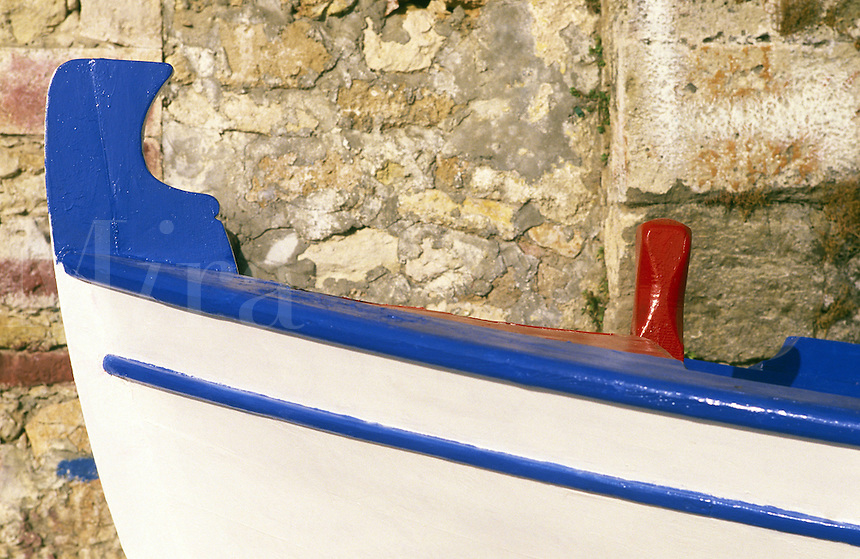 The brightly-painted prow of a fishing boat in the old harbor at Hania. Crete, Greece.