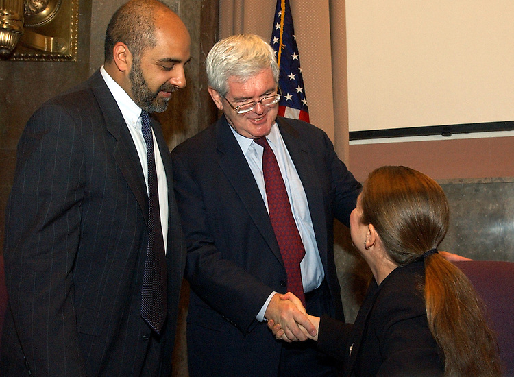 """Former Speaker of the House Newt Gingrich, now with the Center for Health Transformation, greets Carol Diamond of the Markle Foundation, before a news briefing entitled """"Making the Connection: Helping Health Care Providers Collaborate Via Health Information Networks.""""  The discussion was hosted by The Robert Wood Johnson Foundation.   Micky Tripathi of Massachusetts eHealth Collaborative, appears at right."""