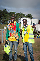 Two scouts from Surinam on their way to their shift at the bus stop arrival