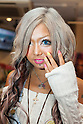 Rise, a member of staff, poses for a picture at the Ganguro Cafe &amp; Bar in the Shibuya shopping area on September 4, 2015. <br /> <br /> Ganguro is an alternative Japanese fashion trend which started in the mid-1990s where young women, rebelling against the traditional idea of Japanese beauty, wore colorful make-up and clothes and had dark-skin.<br /> <br /> 10 Ganguro fashion girls work in the new bar, which offers original Ganguro Balls (fried takoyaki style sausage balls in black squid ink batter) on its menu. Ganguro Caf&eacute; &amp; Bar also offers special services such as Ganguro make-up and the chance to take purikura (photo booth pictures) with staff and to look like a Ganguro girl walking around the Shibuya streets.<br /> <br /> The bar is popular with both Japanese and foreigners and has menus translated in English. (Photo by Rodrigo Reyes Marin/AFLO)
